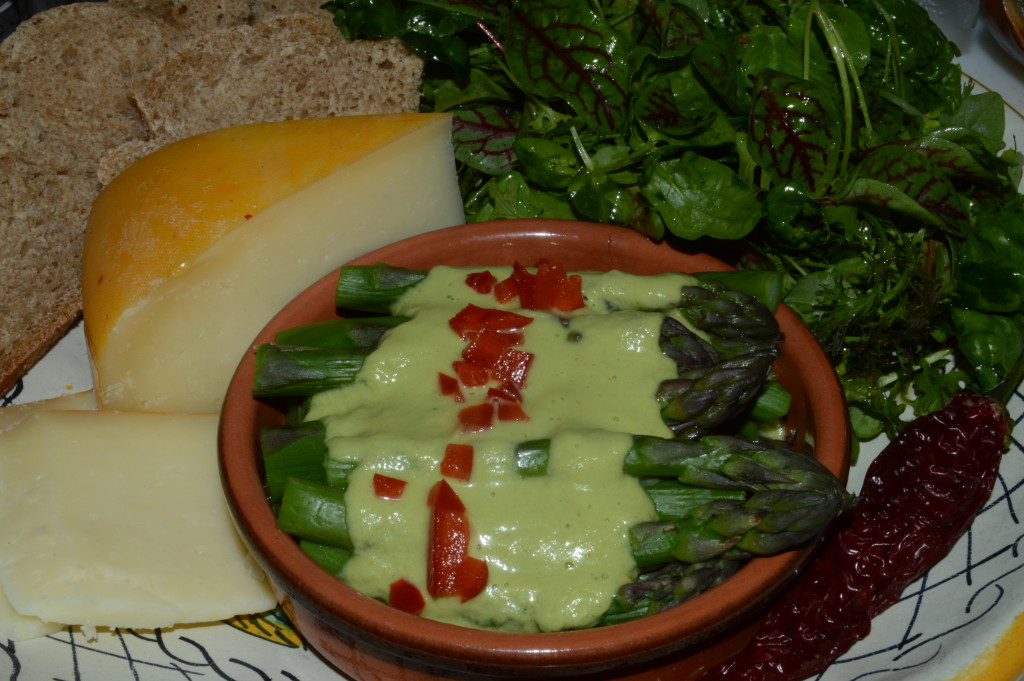 I whizzed the cooked asparagus stalks and micro green stems with their water in my VitaMix and added a little oil and lemon and salt and pepper to make a sauce for the asparagus tips. We had that delicious little treat along with a micro green salad dressed in extra virgin olive oil, lemon, salt and pepper -- and some of the Ludwig Farmstead Creamery cheese with my homemade spelt challah. A perfect lunch after a perfect morning in the Market.
