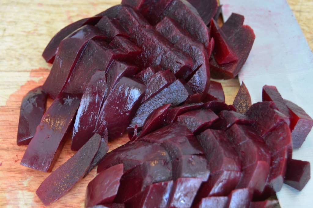 Boiled and peeled beets cut in a julienne.