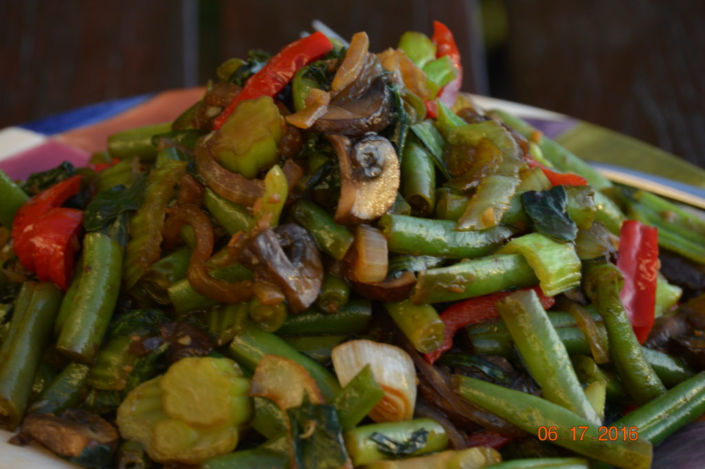 Stir-fry with Bok choy, green beans, red bell pepper, mushrooms, garlic, lots of onion, fresh ginger root, salt and a bit of soy sauce.