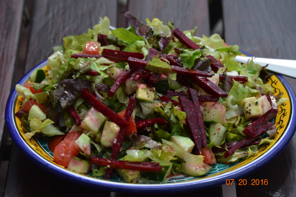 Salad ... with my beautiful greens, tomato, cucumber, beets, green onion, avocado ... and always dressed with extra virgin olive oil, freshly squeezed lemon, salt and sometimes freshly ground black pepper.